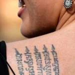 Angelina Jolie Khmer tattoo detail
