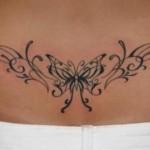 Modèle tatouage papillon tribal bas du dos