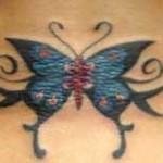 Modèle tatouage papillon bas du dos