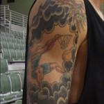 Bras droit tatouage de basketteur