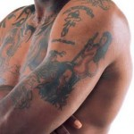 Tatouage bras Dennis Rodman détail