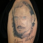 Tatouage de portrait de Johnny Hallyday d'un fan