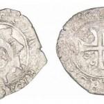 Monnaie ancienne avec dauphin et croix celtique