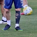 tatouage sur le mollet de Lionel Messi