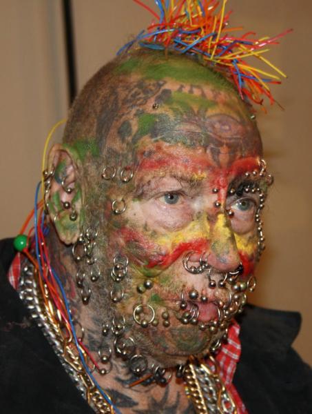 Hommes et femmes les plus tatou s du monde tatouage for Le plus beau coq du monde