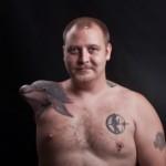 tatouage insolite de dauphin sur le moignon