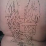 Tatouage raté ailes d'ange dans le dos
