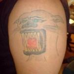 Tatouage raté de Tigre, ou de lion, ou de puma ?